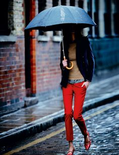 red pants, denim shirt, tan sweater.