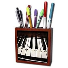 Yves Creations Musical Notes - Piano Keys - Tile Pen inch tile pen holder Dimensions: L x 1 W x 5 1 H Includes 1 - x high gloss ceramic tile Made out ofSolid wood 3 holes for utensils Image on one side Note Holders, Pen Holders, Buy Tile, Old Wagons, Wooden Wheel, Piano Keys, Desk Clock, Pencil Holder, Light Switch Covers