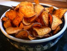 """""""Sweet potato crisps! Oven to 400 degrees. Slice a large sweet potato with mandolin slicer...thin blade. Spread on cookie sheet and drizzle with melted coconut oil. Season as you like (I did sea salt, TJ's 21 spice mix, and smoked paprika). Roast until crispy about 15 - 20 min, stir frequently."""" #PrimalBliss"""