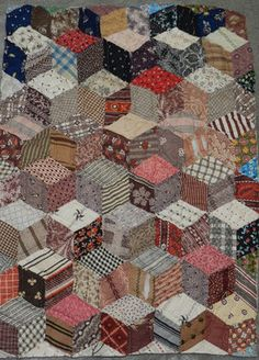 Primitive antique tumbling blocks on eBay, cutter quilt,  love the browns