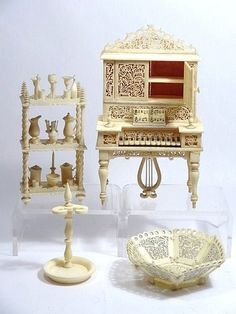 "Antique Miniature Dollhouse Bone Furniture - 	Group of miniature dollhouse bone furniture: piano, umbrella stand, shelf with accessories, bowl, tallest 4.5""."