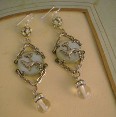 Doggone It - Antique Mother of Pearl Greyhound Dog Pools of Light Rhinestones Recycled Repurposed Assemblage Earrings. $49.99, via Etsy.