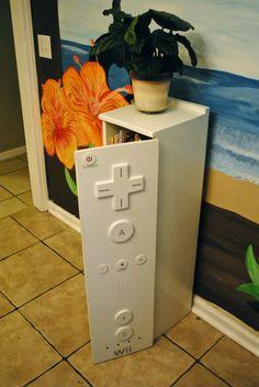 Armario feito em formato de WII. Este movel seria bonito para uma sala de jogos para organizar todos os jogos de Wii e acessórios ..