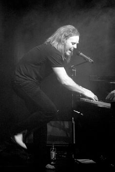Tim Minchin. This pic pretty much says it all, lol, dude is awesome.  Hilarious comedian, great singer, and badass musician.