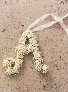 baby's breath monogram- We're putting these on the doors of the church!