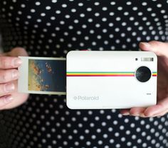 The Polaroid Z2300 - It's a digital camera that makes beautiful instant prints at the push of a button. $160
