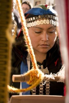 Mapuche woman. The Mapuche are a group of indigenous inhabitants of south-central Chile and southwestern Argentina, including parts of present-day Patagonia.