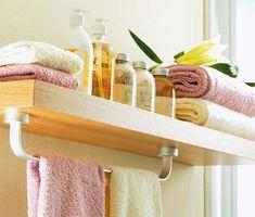 30 Creative and Practical DIY Bathroom Storage Ideas : such as this one by adding a towel bar underneath a shelf for extra towel storage.