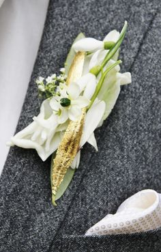 Lovely delicate contemporary white boutonniere with ornithogalum, snowdrops and gold leaf accents for the modern groom.  | By Ulrich Stelzer at http://meisterflorist.com/ |