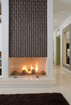 This tile above the fireplace is very retro, and an interesting alternative to a true mantle.  But it's a nice clean pattern and I like how it kind of mirrors the wallpaper peeking out down the hall.