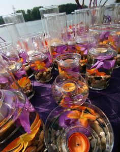 Purple & orange reception table deco