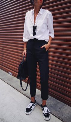 great outfit idea for work : white shirt bag pants sneakers