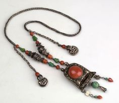 Mongolian necklace with pendant; metal (silver), beads (turquoise, coral, silver)   Acquired 2003