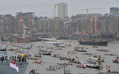 Boats take part in Queen Elizabeth's Diamond Jubilee pageant on the River Thames