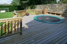 Trampoline decking - this is what I'm taiking about!!!!!  SOO much better than a sunken one. No worries about drainage. Nice.