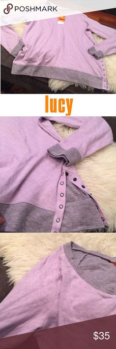 Lucy Purple Athletic Sweatshirt Accent Buttons Lucy Purple Athletic Sweatshirt with Side Accent Buttons. 22 inch bust. 27 inches long. New with tags. No flaws or stains. Feel free to make an offer or bundle and save! Lucy Tops Sweatshirts & Hoodies