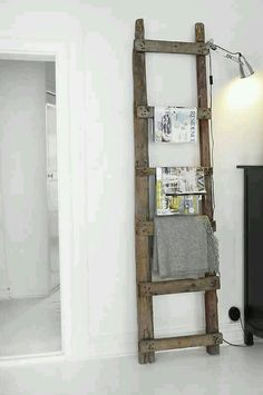 Love the use of erect ladder as piece of furniture to showcase items! Really great for small space.