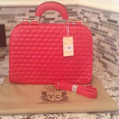 Authentic Mon Santino Handbag Elegant Ruby Red Handbag with Gold Hardware. Back outside zipper, Shoulder Strap, 1 inside zipper, 2 pouch compartment to hold cell phone and keys. Comes with Dust Cover. Mon Santino Bags