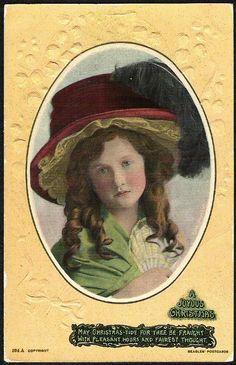 A JOYOUS CHRISTMAS girl wearing a big feathered hat by SamEphemera, $14.99