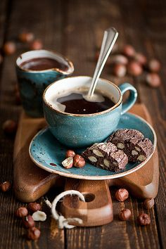 The blue of the cup and saucer, the mocha brown of the table and the beans, the COFFEE and the biscuits. It's almost too close to heaven.