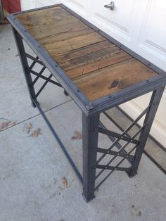 This Unique piece of industrial furniture is crafted from hot rolled steel, and reclaimed pine. All of the Fabrication: Cutting, grinding, welding, drilling, riveting, wood finishing and construction is done by hand, one part at a time. This custom made industrial tablet would work #industrialfurniture