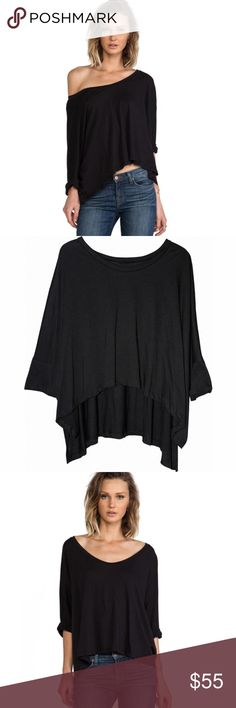 "LNA Black Loose Oversize Relaxed Fit Cape Tee LNA Women's Black Loose Oversized Relaxed Fit Solid Cape Tee  The LnA Long Sleeve Cape Tee is the caped crusader of post-modern fashion.  Made from a soft cotton, the tee features an ultra-relaxed fit with 3/4 sleeves.  It is draped to please; wear it as a scoop neck or as an off-the-shoulder tee.  Color: Black Fabric: 100% Cotton Care: Wash Cold Approx Length from Shoulder to Hem: 25"" Made in the USA LNA Tops Tees - Long Sleeve"