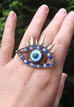 spiky blue eye ring