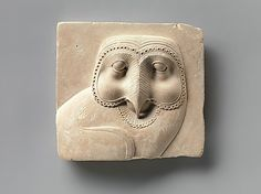 Relief plaque with face of an owl Period: Late Period–Ptolemaic Period Date: 400–30 B.C. Geography: Egypt Medium: Limestone