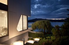Elegant Austrian Home Blends Lovely Lake Views With A Minimalist Interior