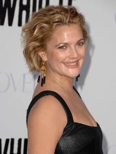 Drew Barrymore ~Drew balances her elegant earrings with a playful look by brushing back her wavy, undone bob.