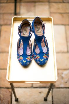 Who wants to add their something blue like this? We do! #blueshoes #somethingblue #thatperfecttouch http://www.weddingchicks.com/2013/11/08/family-style-wedding-2/