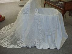 baby basket made from wedding dress