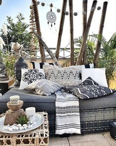 Such an inviting way to decorate your small balcony or patio.  I want to just curl with a good book and my cat.