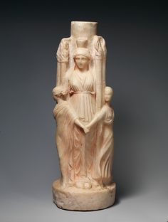 An ancient Roman triple representation of Hekate, dark goddess of the crossroads, magic and the lunar underworld, flanked by the three Graces. (Metropolitan Museum of Art)