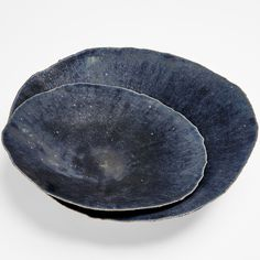 Exclusively at ABC, ceramic platters are handcrafted in a range of subtle, inky blue tones. Designed by Nathalie Sonnet, this unique collection is inspired by the night sky and displays the artist's ability to balance artistry and craftsmanship. Made in France.