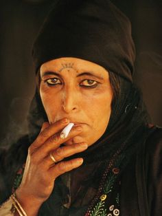 Bedouin Woman Photograph by Annie Griffiths Belt An intimate portrait of a Bedouin woman captures the enduring traditions of those who call Petra home. The woman's forebears were among the Bedouin encountered in 1812 by Swiss scholar Johann Burckhardt, the first modern European to see the ruined Nabataean city of ancient lore, which vanished from most maps in the seventh century.