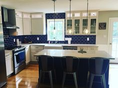 Stunning cobalt kitchen island with complimenting Cobalt Glass Subway Tile backsplash. Very bold and very beautiful!