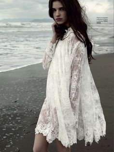 wearing a lacey dress on the beach