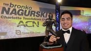 Linebacker Manti Te'o, won 2 national player of the year awards Thursday night at Walt Disney World in Lake Buena Vista, FL.  He won the Maxwell Award, given to the nation's most outstanding player, becoming the first defensive player to win the award since 1980.  Te'o added the Walter Camp national player of the year award, becoming the fourth Notre Dame player to do so. He won the Bednarik defensive player of the year award and had previously won the Butkus, Nagurski and Lombardi awards.