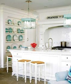 White kitchens are the perfect blank canvas: i love how you can incorporate color so effortlessly and best of all, it's easy to change when another color comes along! Love the brightness and clean look of white!