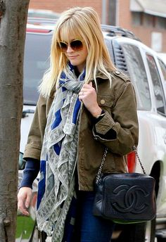 Reese Witherspoon looking chic and cozy in a military jacket and timeless Chanel bag