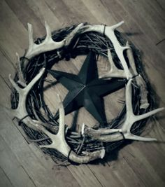 My deer antler wreath! Antlers are real (from husband) and other supplies include grape vine wreath, metal star and wire to attach all from hobby lobby. Makes a nice rustic or country style wreath. (Photo only).