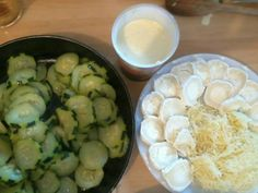 courgette, crème épaisse, ail, oeuf, chèvre, gruyère râpé, Poivre, Sel, Huile d'olive