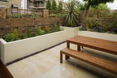 Rendered planters and timber bench