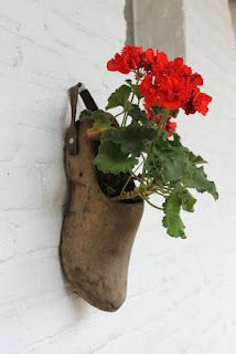We always love the idea of making a shoe into a #garden #planter.  Fun!