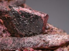 Allanite-(Ce),  (Ce,Ca,Y)2(Al,Fe+++)3(SiO4)3(OH), Olden Township, Ontario, Canada. Crystal with fairly good lustre and the often present red-brown coloration of hematite