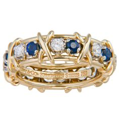Tiffany & Co. Schlumberger Sapphire Diamond X Ring | From a unique collection of vintage band rings at http://www.1stdibs.com/jewelry/rings/band-rings/