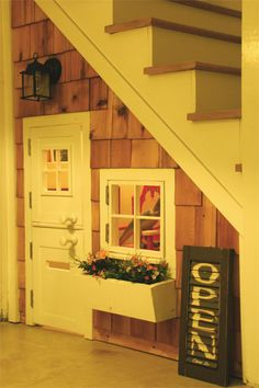 A play house under the stairs! So cute in a basement!