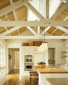 a frame, exposed beams, butcher block counter tops, pendant lighting, open shelving   ... except for the open shelving I love this... my dishes etc arent pretty enough for open shelves