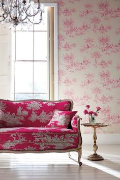 Bright pink toile sofa and wallpaper!
